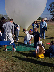 Students prepare payload for launch during the 2004 debut of Changes in Altitudes, a program that's turning Arizona kids onto high-altitude atmosphere exploration. (Photo: NAU/NASA Space Grant)