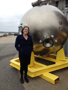 Bonnie Hurwitz next to the metal pod that serves as the main chamber for the Alvin submersible that scientists operate to collect samples from the deepest parts of the ocean not accessible to people. Photo taken at Woods Hole Oceanographic Institution. (Photo: Stefan Sievert)