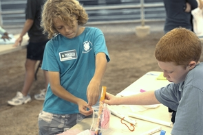 Junior rocket scientists attach a payload to their rocket prototype. (Photo: Ian Brewer)