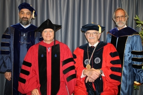 From the left: Phil Pinto, UA assistant professor of astronomy and physics; Brian Schmidt, UA graduate commencement speaker and Nobel Laureate; UA President Eugene G. Sander; and Joaquin Ruiz, executive dean of the UA Colleges of Letters, Arts and Science. (Photo credit: Rebecca Ruiz McGill/UANews)
