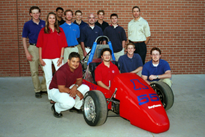 UA's SAE Formula Car Team posed for a photo before going to Pontiac, Mich. for the annual Formula SAE competition. Raytheon's UA campus manager, Brian Perry, is in the white shirt, standing at right in the back row.