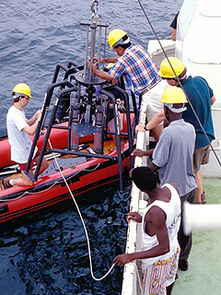 Preparining the Hedrick Marrs Multicorer for collecting sediment cores in Lake Tanganyika.  Andrew S. Cohen photo.