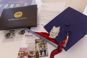 In preparation for the virtual ceremony, thousands of graduates opted to receive kits that included mortarboards, tassels and a diploma cover or a notepad and pen, along with a note from the president and provost congratulating graduates on their accomplishments. (Photo: Chris Richards/Arizona Alumni Association)
