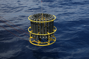 A CTD device that measures water conductivity (salinity), temperature and depth is mounted underneath a set of water bottles used for collecting  samples at varying depths in a column of water. (Photo: Tara Clemente, University of Hawaii)