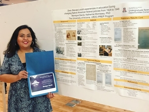 Monique Davila with her Katheryne B. Willock Library Research Award.