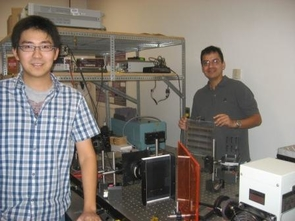 Front left, Deming Zhang and Jose Castro are apply theory to application as they work on improving solar cell efficiency with holograms in professor Kostuk's lab.