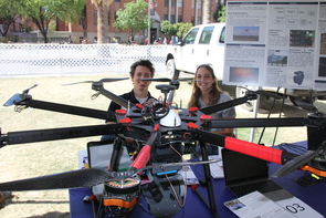 Members of Team 17003 display their low-cost unmanned aircraft-based lidar scanning system.