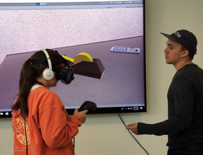 Tech Core mentor and emerging technologist Devon Oberdan (right) uses Nano 2020 to instruct a management information systems undergraduate student in the use of virtual reality.
