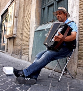 Tourist destinations in Rome, like the Pantheon, tend to attract various street performers such as this accordion player. (Photo by Melissa Guz)
