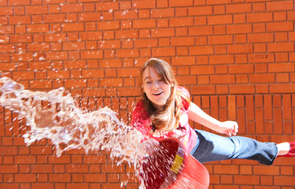 Engineering management senior Erika Gibson tries an unconventional water-delivery method in a 2011 E-Week event organized by Engineers Without Borders and based on their water-supply projects in Africa.