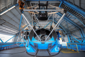 A view of the WIYN telescope showing the primary mirror and telescopes structure. (Photo: NSF's National Optical-Infrared Astronomy Research Laboratory/KPNO/NSF/AURA)