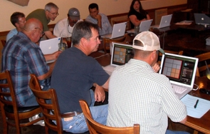 Playing FarmVille in the real world: Ellsworth developed a computer simulation to teach growers the benefits of considering crop choice, crop selection and crop placement on their surrounding farms to minimize risks of invasion by Lygus bugs, a major cotton pest. (Photo: APMC)