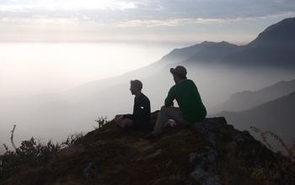 David Marty and Mike Reed, Peace Corps Peru volunteers, enjoying a quiet moment in the mountains.