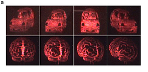 Views of an automobile (top) and of a human brain (bottom) from the updatable 3-D holographic display developed at The University of Arizona College of Optical Sciences in collaboration with Nitto Denko Technical Corp., Oceanside, Calif. The 3-D images were recorded on a 4-inch by 4-inch photorefractive polymer device. (University of Arizona College of Optical Sciences/Nitto Denko Technical Corp.) (Click to enlarge.)