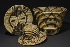 Coiled baskets from Second Mesa, made from yucca and galleta grass. From left: Hiilili katsina plaque, ca. 1975; Novelty hat, ca. 1920; Bowl with antelope and cloud design, ca. 1945. (Photo courtesy of Arizona State Museum)
