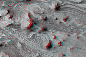 Swirls of rock appear on the floor of Candor Chasma, about 4 kilometers, or 2.5 miles, below the crater rim in this anaglyph taken by the High Resolution Imaging Science Experiment on NASA's Mars Reconnaissance Orbiter.  The scene takes on a dramatic, three-dimensional aspect when viewed with 3D color filter glasses.