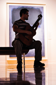 Chilean Master's student and Fulbright scholar Pablo Gonzalez cradles a guitar at one of the regular Friday morning performances at the UA Museum of Art. (Photo: Patrick McArdle/UANews)