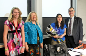 Guzin Bayraksan, holding flowers, accepts her Five Star Teaching Award from selection committee head Lizzie Greene, far left, Honors College Dean Pat MacCorquodale, and College of Engineering Dean Jeff Goldberg, far right.