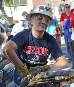"Allison Hagerman is determined to make a good showing here at her last UA jackleg drilling competition in April. Hagerman intends to carry that resolve, along with an abiding respect for safety and an appreciation for those who came before her, into her mining engineering career. ""It's important to always remember that the older folks are there to teach you. I learn something new every day,"" said the new graduate and captain of the UA women's mine rescue team. (Photo by Patrick McArdle/UANews)"