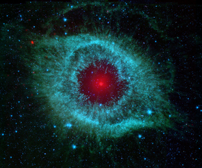 The Spitzer Space Telescope has provided glimpses into the very beginnings of our own existence as well as into the far future of our solar system. This infrared image shows the Helix nebula, which is located about 700 light-years away in the constellation Aquarius. Our own sun will blossom into a similar planetary nebula when it dies in about five billion years. (Image: NASA/JPL-Caltech/UArizona)