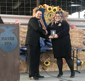 At the urging of FFA academic advisor Jeff Dinges (left), Humbarger (right) applied for and received several scholarships and grants, including the Mary Kidder Rak Scholarship, available to students in the College of Agriculture and Life Sciences at the UA.
