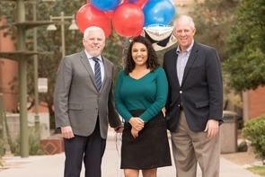 Leah Crowder with UA Honor's College Dean Terry Hunt (left) and UA President Robert C. Robbins. (Photo: Chris Richards/UA Alumni Association)