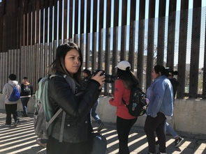 Carmen Valencia, a former journalism undergraduate student, gets ready to take a photograph during a tour of Ambos Nogales. (Photo courtesy of Celeste González de Bustamante)