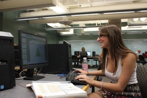 Sara Mason uses the technology in the Main Library's Information Commons to work on a project. The Information Commons is open 24 hours. (Photo courtesy of Alexander Ganz)