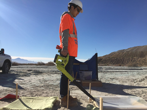 Materials science and engineering doctoral student Taehee Lee uses a blower to create a 25 mph wind to measure generated dust concentrations from the surface where dust suppressants were applied two weeks prior. The tests were done at the closed tailings storage facility at the Asarco Mission Mine. (Photo: Minkyu Kim/College of Engineering)