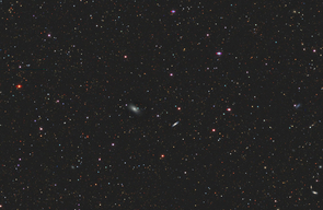 A view of galaxies and other objects collected by a series of surveys in preparation for DESI, the Dark Energy Spectroscopic Instrument. The university's Bok Telescope was instrumental in identifying targets for the DESI survey. (Image: DESI Legacy Imaging Surveys)