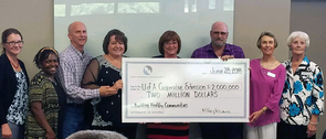 """Evelyn Whitmer (fourth from left) represented UA Cooperative Extension when the Legacy Foundation of Southeast Arizona presented a $2 million grant to fund """"Building Healthy Communities."""""""