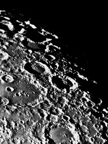 This is an image of the lunar highlands from the Consolidated LunarAtlas, which was produced during the Apollo Era by the UA Lunar and Planetary Laboratory. The new study by Strom, Malhotra, Kring and their Japanese colleagues indicates this terrain was bombarded mostly by asteroids -not comets - that were flung into the inner solar system when the asteroid belt was destabilized by migrating giant planets.  The Earth wassimilarly bombarded but geological activity has erased most evidence ofthat bombardment.  This historical image of the heavily cratered lunarterrain was taken on 1 April 1966. (Photo courtesy of LPL Space Imagery Center)