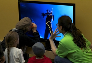 Visitors at the event explore 3-D television. (Photo: Raymond Sanchez)