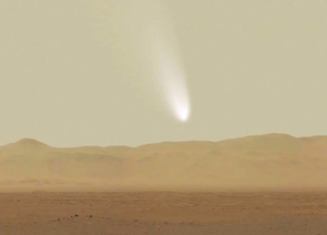 An artist's impression of the comet Siding Spring looming over the red planet's horizon. (Image: NASA)