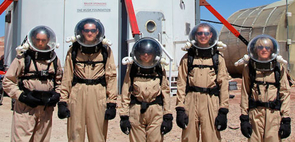 """Some of Crew 117 in front of the """"hab,"""" left to right: videographer Daniel Land, and NASA RISA project team members Kyle Stephens, Jackeline Mayer, Samuel Martin and Parker Owan."""