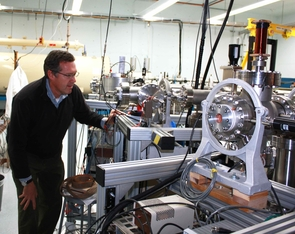 Greg Hodgins checks on the accelerator mass spectrometer, which narrowed the age of the book down to 1404 to 1438, in the early Renaissance. (Photo by Daniel Stolte/UANews)