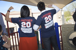 Cazandra Zaragoza and Ivan Aispuro show off their Match Day T-shirts. (Photo: Kris Hanning/University of Arizona Health Sciences)
