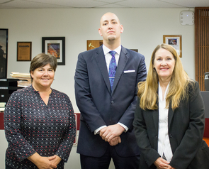 Angela Menard (left) and Lori Lewis (right) teach and supervise students such as Jonathan Rich (center) as they gain real-world experience through the Veterans' Advocacy Law Clinic and Veterans Court. (Photo: Alejandra Cardenas/UA James E. Rogers College of Law)