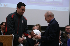 UA basketball coach Sean Miller presents a signed basketball to Jim Wyant, a longtime Wildcats basketball fan, at Tuesday's celebration.
