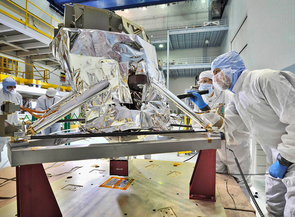 """Contamination control engineers conducted a """"receiving inspection"""" of the James Webb Space Telescope's Mid-Infrared Instrument (or MIRI) in the giant clean room at NASA's Goddard Space Flight Center in Greenbelt, Md. As part of the standard receiving inspection, they are looking for the tiniest traces of dust or contamination, which would have to be remedied because cleanliness is a priority for such a sensitive instrument. (Photo: NASA/Chris Gunn)"""