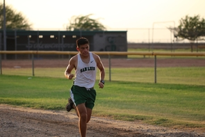 Morales picked up sports again as a freshman in high school after an illness for several years kept him off the trail and field. He is pictured running in a cross-country event during his senior year.  (Photo courtesy of Alexis Morales)