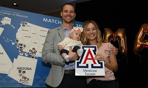 Nathan and Deanna Sherman and their baby daughter celebrate Nathan's match to the orthopedic surgery residency program at the College of Medicine – Phoenix. (Photo: Rick Kopstein/UAHS Biocommunications)