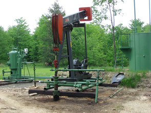 Oil and gas well with brine separator tank in background in southern Ontario, Canada. (Photo: Jennifer McIntosh)
