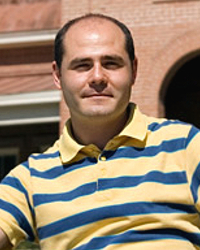 """While a doctoral candidate at the UA, Michele Pavanello, shown here in front of Old Main, was part of a study that could lead to new insight on how the universe's first stars formed. """"We could do this research in Arizona not just because we happened to be there,"""" he said, """"but because the UA has these great facilities."""" (Photo courtesy of Michele Pavanello)"""
