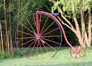 """The earliest bicycle design, called the """"ordinary,"""" """"penny farthing"""" or """"hi-boy,"""" was very tall with a disproportionately large front wheel. The introduction of the """"safety"""" design seen in modern bicycles made riding more accessible to all, beginning in the 1890s."""