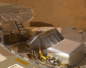 Several of the trenches dug by NASA's Phoenix Mars Lander are displayed in this approximately true color mosaic of images from the lander's Surface Stereo Imager camera.
