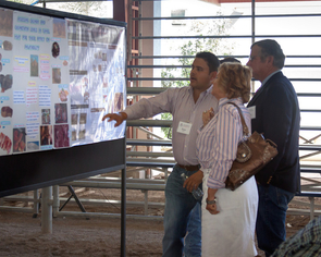 Sam Garcia, a doctoral candidate in animal sciences, presented a research poster to guests at the school's dedication.
