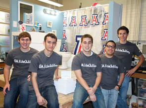 Members of the UA Rube Goldberg club in front of their contraption designed to inflate and burst a balloon. Note Wilma Wildcat lurking behind the shower curtain. How does it work? All will be revealed at the Western Region Rube Goldberg Competion Feb. 25 in Crowder Hall on the UA campus.