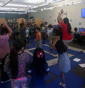 Saludable made learning about health and nutrition fun for children, who learned yoga as part of the six-week program.