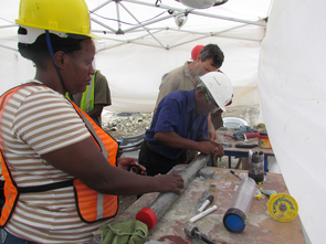 From left to right: Study co-authors Veronica Muiruri, Anthony Mbuthia and Andrew Cohen label a freshly sealed sediment core sample from Lake Magadi, Kenya. (Photo: Anne Billingsley)
